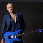 Phil Collen, Lead Guitarist for the Band Def Leppard, Talking Music, Meeting Joe Elliot, Touring, Song Writing, Covid-19, Rick Allen Story, Fitness, Vegan Lifestyle and Personal Development with Jim Rohn Founder, Kyle Wilson